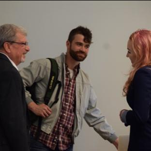 Three people conversing