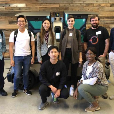 grad students on the Silicon Valley Trek pose on site at a company