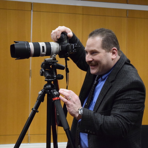 Mr. Roger Theise, photographer, taking a picture