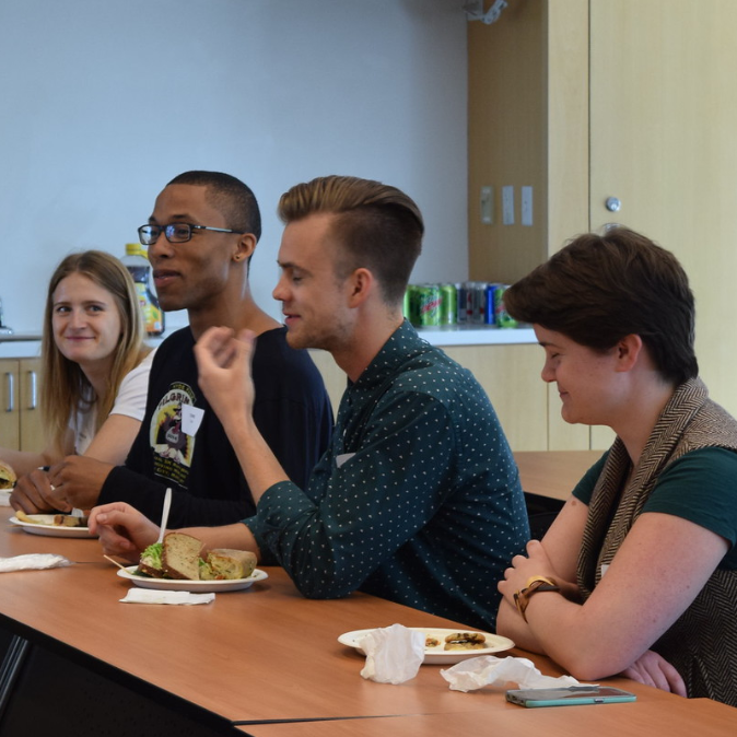 Four students in an informal discussion at a Careers Beyond Academia event